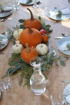 Pumpkins and greenery centerpiece