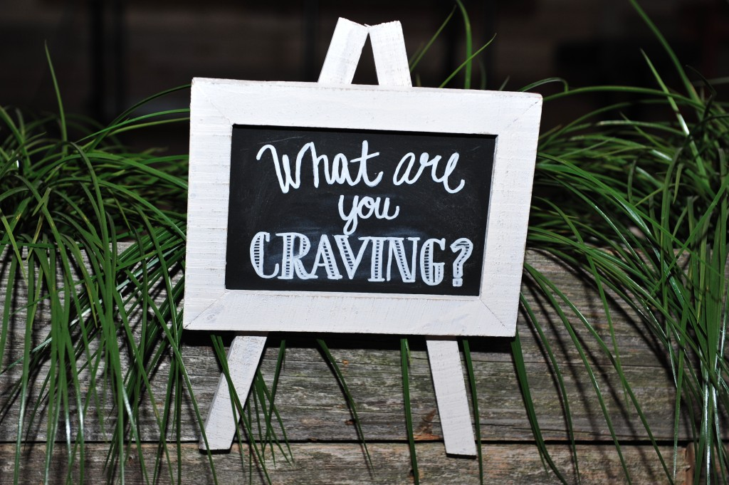 "Gender Reveal ""What are you Craving"" sign on dessert table"